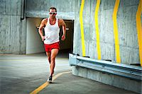 runner (male) - Man Running on Urban Road Stock Photo - Premium Rights-Managednull, Code: 822-06302658