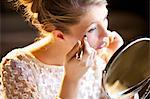Young Woman Applying Concealer Stock Photo - Premium Rights-Managed, Artist: ableimages, Code: 822-06302665