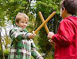 Two Boys Playing at Sword Fighting Stock Photo - Premium Rights-Managed, Artist: ableimages, Code: 822-06302691