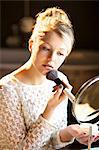 Young Woman Applying Blush Stock Photo - Premium Rights-Managed, Artist: ableimages, Code: 822-06302700