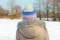 Back View of Girl in a Parka and Wool Hat Outdoors Stock Photo - Premium Rights-Managednull, Code: 822-06302703