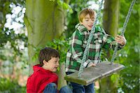 Two Boys Playing on a Swing Stock Photo - Premium Rights-Managednull, Code: 822-06302709