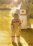 Boy Wearing Space Suit Standing in front of Cardboard Rocket Spacecraft Stock Photo - Premium Rights-Managed, Artist: ableimages, Code: 822-06302730