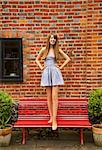 Teenage Girl Standing on Red Bench Stock Photo - Premium Rights-Managed, Artist: ableimages, Code: 822-06302737