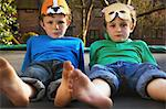 Two Boys Wearing Masks Lying on Trampoline Stock Photo - Premium Rights-Managed, Artist: ableimages, Code: 822-06302748