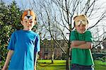 Two Boys with Masks  on Forehead Making Funny Faces Stock Photo - Premium Rights-Managed, Artist: ableimages, Code: 822-06302761