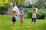 Children Wearing Homemade Cardboard Helmets Playing around Rocket Spacecraft Stock Photo - Premium Rights-Managed, Artist: ableimages, Code: 822-06302781