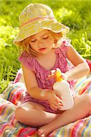 Young Girl Applying Suntan Lotion on Arm Stock Photo - Premium Rights-Managednull, Code: 822-06302817