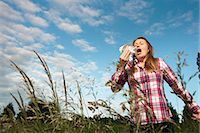 people coughing or sneezing - Woman sneezing in tall grass Stock Photo - Premium Royalty-Freenull, Code: 649-06304861