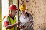 Construction workers examining papers Stock Photo - Premium Royalty-Free, Artist: Cultura RM, Code: 649-06304896