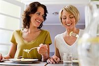 Smiling women having lunch together Stock Photo - Premium Royalty-Freenull, Code: 649-06304999