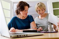 Women working together on laptop Stock Photo - Premium Royalty-Freenull, Code: 649-06305004