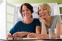 Women using laptop together Stock Photo - Premium Royalty-Freenull, Code: 649-06305007