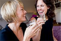 Women drinking champagne together Stock Photo - Premium Royalty-Freenull, Code: 649-06305010