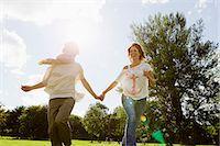 Smiling women running outdoors Stock Photo - Premium Royalty-Freenull, Code: 649-06305014