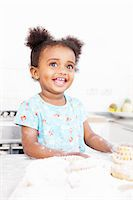 Smiling girl baking in kitchen Stock Photo - Premium Royalty-Freenull, Code: 649-06305114