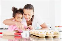 Mother and daughter baking together Stock Photo - Premium Royalty-Freenull, Code: 649-06305118