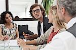 Business people working together at desk Stock Photo - Premium Royalty-Free, Artist: CulturaRM, Code: 649-06305275