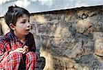 Boy examining moth on stone wall Stock Photo - Premium Royalty-Free, Artist: Janet Foster, Code: 649-06305337