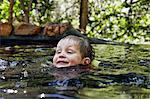 Boy swimming in river in forest Stock Photo - Premium Royalty-Free, Artist: Minden Pictures, Code: 649-06305349