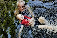 Older man teaching grandson to swim Stock Photo - Premium Royalty-Freenull, Code: 649-06305351