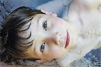 Close up of boys face in river Stock Photo - Premium Royalty-Freenull, Code: 649-06305352
