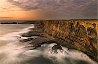 rugged landscape - Fog rolling up to rocky coastal cliffs Stock Photo - Premium Royalty-Freenull, Code: 649-06305388