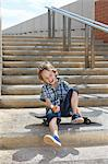 Boy sitting on skateboard on steps Stock Photo - Premium Royalty-Free, Artist: Aflo Sport, Code: 649-06305503