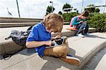 Boy using tablet computer outdoors Stock Photo - Premium Royalty-Free, Artist: Robert Harding Images, Code: 649-06305514