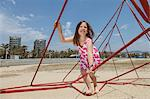 Girl playing on ropes on beach Stock Photo - Premium Royalty-Free, Artist: ableimages, Code: 649-06305526