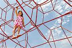 Girl playing on ropes outdoors Stock Photo - Premium Royalty-Free, Artist: CulturaRM, Code: 649-06305529