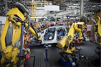 production - Robots welding car body in car factory Stock Photo - Premium Royalty-Freenull, Code: 649-06305614