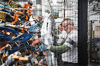 production - Workers handling car parts in car factory Stock Photo - Premium Royalty-Freenull, Code: 649-06305619