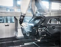 Paint spraying robots in car factory Stock Photo - Premium Royalty-Freenull, Code: 649-06305668