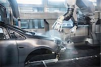 Paint spraying robots in car factory Stock Photo - Premium Royalty-Freenull, Code: 649-06305669