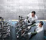 High angle portrait of engineers inspecting press parts in car factory