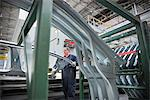 Worker with pressed steel car parts in car factory Stock Photo - Premium Royalty-Free, Artist: Blend Images, Code: 649-06305700