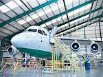 Workers inspecting jet aircraft in hangar Stock Photo - Premium Royalty-Free, Artist: Blend Images, Code: 649-06305704