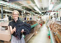 Worker with fabric in garment factory Stock Photo - Premium Royalty-Freenull, Code: 649-06305900