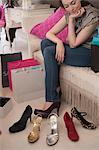 Woman trying on shoes in store Stock Photo - Premium Royalty-Free, Artist: Atli Mar Hafsteinsson, Code: 649-06305970
