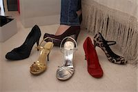 Woman trying on shoes in store Stock Photo - Premium Royalty-Freenull, Code: 649-06305971