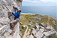 rock climber - Climber scaling steep cliff face Stock Photo - Premium Royalty-Freenull, Code: 649-06306006