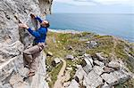 Climber scaling steep cliff face Stock Photo - Premium Royalty-Free, Artist: ableimages, Code: 649-06306006