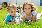 Boy and girl playing with a rabbit Stock Photo - Premium Rights-Managed, Artist: F1Online, Code: 853-06306015
