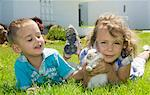 Boy and girl playing with a rabbit Stock Photo - Premium Rights-Managed, Artist: F1Online, Code: 853-06306018