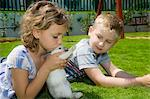 Boy and girl playing with a rabbit Stock Photo - Premium Rights-Managed, Artist: F1Online, Code: 853-06306021