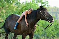 Girl lying on horse Stock Photo - Premium Rights-Managednull, Code: 853-06306082