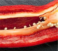 paprika - Red Pepper Sliced to Reveal Seeds and Ribs Stock Photo - Premium Royalty-Freenull, Code: 659-06306189