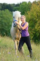 preteen  smile  one  alone - Smiling girl with horse on meadow Stock Photo - Premium Rights-Managednull, Code: 853-06306120
