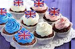 Chocolate cupcakes decorated with coloured cream and Union Jacks Stock Photo - Premium Royalty-Freenull, Code: 659-06306632